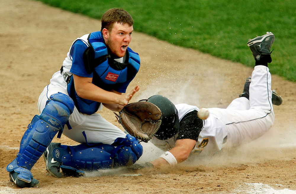 Tuscola's Dane Winn (13) slides into home plate as Argenta-Oreana's Dylan Whicker (9) waits for the ball during the Schlarman High School IHSA sectional game at Danville Stadium Thursday, May 22, 2008, in Danville, Ill.