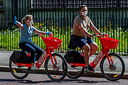 Electric Jump Bikes from UBER - People are out exercising on bikes and on foot, some in masks and some not. Central London is pretty crowded as the sun comes out again. The 'lockdown' continues for the Coronavirus (Covid 19) outbreak in London.