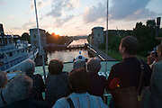 Moscow-Volga Canal, MS Kazan passing the six locks at sunset, together with Russian vessel Sergej Abramov...A river cruise from Moscow to St. Petersburg aboard MS Kazan, the most luxurious vessel (four star plus) operating in Russia. It is run by Austrian River Cruises under strictly Western standards, chartered - amongst others - by Club 50, a senior's travel agency based in Vienna.
