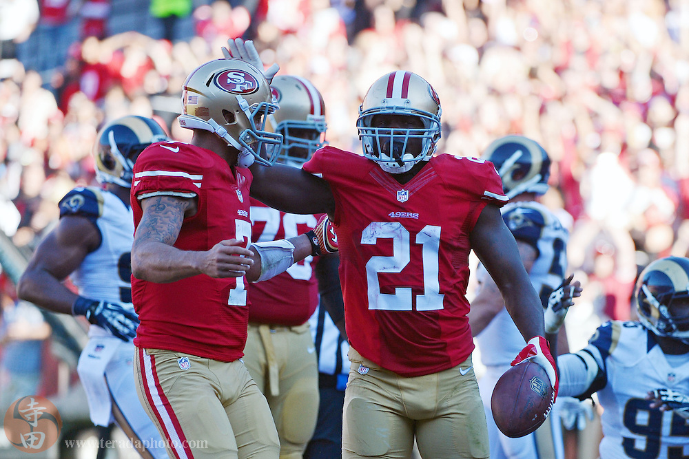 December 1, 2013; San Francisco, CA, USA; San Francisco 49ers running back Frank Gore (21) celebrates with quarterback Colin Kaepernick (7) after scoring a touchdown against the St. Louis Rams during the second quarter at Candlestick Park.