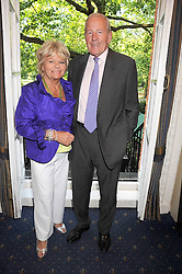 TV presenter JUDITH CHALMERS and her husband MR NEIL DURDEN-SMITH at a party to celebrate the publication on 'Unsuitable' by Suzy Parsons held at St.Stephen's Club, 34 Queen Anne's Gate, London SW1 on 19th June 2008<br /><br />NON EXCLUSIVE - WORLD RIGHTS