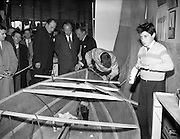 18/04/1960<br /> 04/18/1960<br /> 18 April 1960<br /> The First Annual Boat Show at  Busaras, Store Street, Dublin.<br /> Picture shows: Minister for Transport and Powee Erskine Childers Centre at the stand of Phil Kane, Boatbuilders.