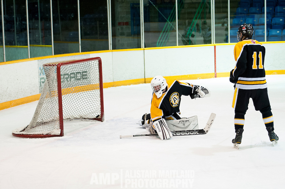 Aldengrove goalie, Cole Andersen watching the second goal of the third period enter the net during the a Midget A game against the Mustangs at Takhini Arena.