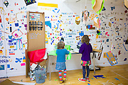 Children making artwork for Atelier Public 2 exhibition of free expression artworks by members of the public, on display in Gallery of Modern Art, GoMA, Glasgow, Scotland