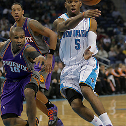 Nov 19, 2009; New Orleans, LA, USA;  New Orleans Hornets guard Marcus Thornton (5) passes the ball as Phoenix Suns guard Leandro Barbosa (10) defends the play during the first half at the New Orleans Arena. Mandatory Credit: Derick E. Hingle-US PRESSWIRE