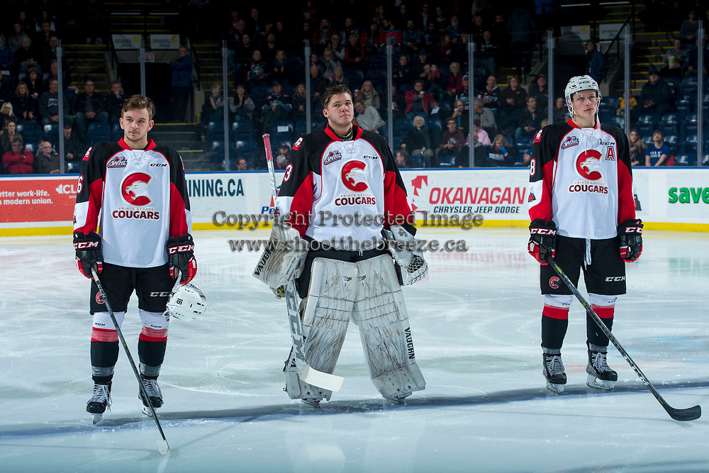 KELOWNA, CANADA - NOVEMBER 29: Ryan Schoettler #16, Isaiah DiLaura #33 and Jackson Leppard #8 of the Prince George Cougars line up on the blue line against the Kelowna Rockets on November 29, 2017 at Prospera Place in Kelowna, British Columbia, Canada.  (Photo by Marissa Baecker/Shoot the Breeze)  *** Local Caption ***