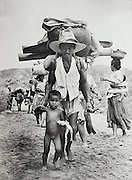 Carl Mydans<br /> LIFE Magazine<br /> Korean War refugees 1950<br /> <br /> Korean refugee child carrying a fish trudges along ahead of her father, part of front that had been quiet for 24 hours. This photograph was published in the January 15, 1951 issue of LIFE Magazine, page 22.<br /> <br /> Details:<br /> Large format exhibition printed by the LIFE magazine photo lab sometime in the 1970s or 1980s. On the reverse in pencil inscription is Mydan's photo credit.<br /> <br /> This is a confirmed Mydans image and can be viewed in the LIFE Picture Collection online archive.<br /> <br /> - Double weight gelatin silver fiber print. <br /> - Size: 14 x 9 3/4 inches.<br /> <br /> Price ¥45,000 JPY<br /> <br /> <br /> <br /> <br /> <br /> <br /> <br /> <br /> <br /> <br /> <br /> <br /> <br /> <br /> <br /> <br /> <br /> <br /> <br /> <br /> <br /> <br /> <br /> <br /> <br /> <br /> <br /> <br /> <br /> <br /> <br /> <br /> <br /> <br /> <br /> <br /> <br /> <br /> <br /> <br /> <br /> <br /> <br /> <br /> <br /> <br /> <br /> <br /> <br /> <br /> <br /> <br /> <br /> <br /> <br /> <br /> <br /> <br /> <br /> <br /> <br /> <br /> <br /> <br /> <br /> <br /> <br /> <br /> <br /> <br /> <br /> <br /> <br /> <br /> <br /> <br /> <br /> <br /> <br /> <br /> <br /> <br /> .
