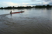 A small boat crosses the Arauca River, which borders Colombia and Venezuela, in the Colombian city of Arauca on June 28, 2009. The border region between Colombia and Venezuela has often been a region with a high level of activity of illegal armed groups. (Photo/Scott Dalton)