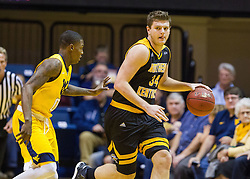 Dec 23, 2016; Morgantown, WV, USA; Northern Kentucky Norse forward Drew McDonald (34) dribbles the ball through pressure by West Virginia Mountaineers guard Teyvon Myers (0) during the first half at WVU Coliseum. Mandatory Credit: Ben Queen-USA TODAY Sports