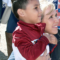 Michelle Lujan Grisham, Democrat candidate for governor of New Mexico, poses with one of her younger fans at a down-home meet-and-greet Saturday in Grants.
