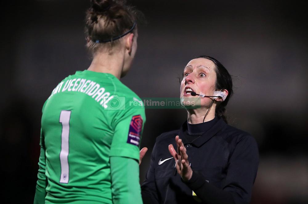 Referee Amy Fearn (right) speaks with Arsenal goalkeeper Sari Van Veenendaal