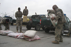 Afghan policemen unload bags of seized hashish during a presentation by Afghan border police in east Afghanistans Nangarhar Province, December 27, 2012. Photo by Imago / i-Images...UK ONLY