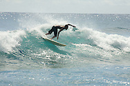 Young male surfers on the Pacific Ocean off the island of Kauai, Hawaii