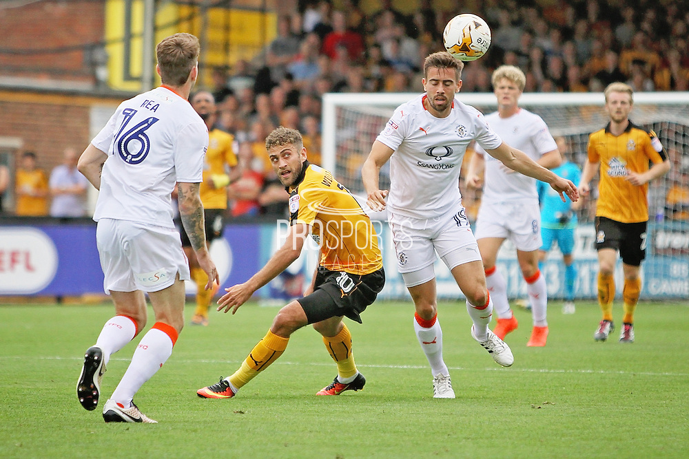 Luton Town midfielder Oliver Lee (19) clears from Cambridge Utd forward Ben Williamson (10) during the EFL Sky Bet League 2 match between Cambridge United and Luton Town at the R Costings Abbey Stadium, Cambridge, England on 27 August 2016. Photo by Nigel Cole.