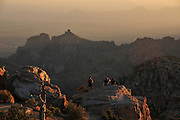 Visitors to flock to Windy Point Vista on Mount Lemmon, Tucson, Arizona, USA, to watch the sun set and the full moon rise.  The vista is about midpoint along the Catalina Highway in the Santa Catalina Mountains of the Coronado National Forest on a Sky Island in the Sonoran Desert.  Thimble Peak is in the distance.