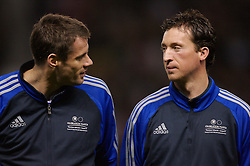 Manchester, England - Tuesday, March 13, 2007: Liverpool players Jamie Carragher and Robbie Fowler share a joke before appearing for a Europe all-star XI against Manchester United during the UEFA Celebration Match at Old Trafford. (Pic by David Rawcliffe/Propaganda)