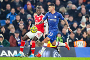 Arsenal forward Nicolas Pépé (19) tussles with Chelsea defender Emerson Palmieri (33) and claims handball during the Premier League match between Chelsea and Arsenal at Stamford Bridge, London, England on 21 January 2020.