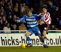 Photo: Leigh Quinnell.<br /> Reading v Southampton. Coca Cola Championship. 10/02/2006. Southamptons Grzegorz Rasiak can't find a way to stop Readings Ivar Ingimarsson.