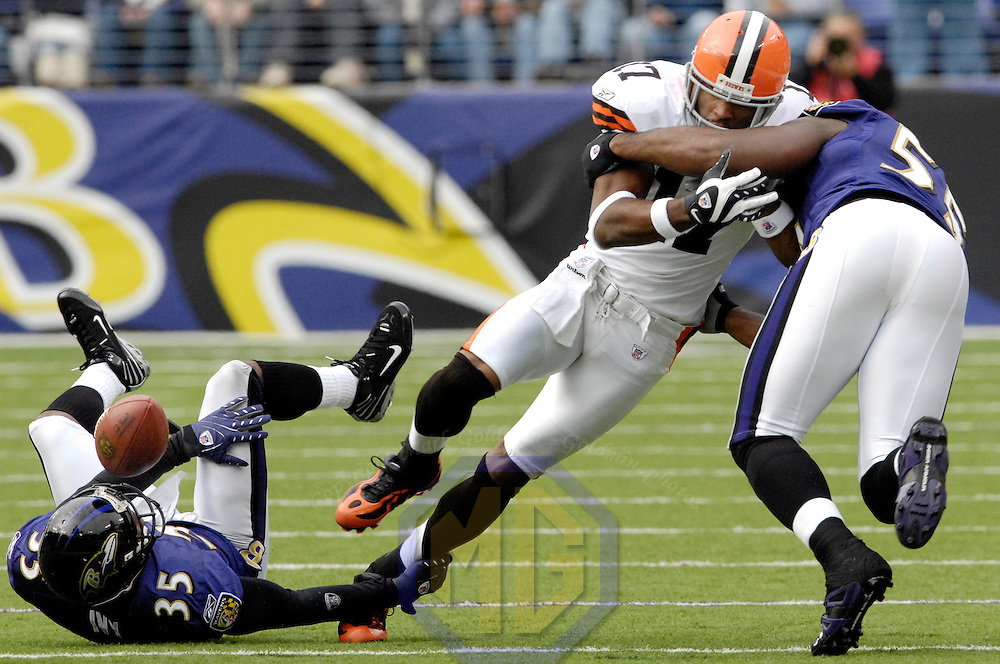 18 November 2007:  Cleveland Browns wide receiver Braylon Edwards (17) fumbles the ball after being hit by Baltimore Ravens cornerback Corey Ivy (35) and linebacker Terrell Suggs (55) in the 1st quarter on November 18, 2007 at M&T Bank Stadium in Baltimore, Maryland. The fumble was recovered by linebacker Ray Lewis.  The Ravens were sent to their 4th consecutive loss with a 33-30 overtime time win by the Browns..