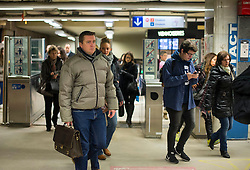 © Licensed to London News Pictures. 25/11/2015. Brussels, Belgium. Commuters at Louise Metro station in Central Brussels where the Metro transport system is now running and some schools have reopened following closure due to security fears. The Belgian capital has been on lockdown and the highest security alert due to fears of a terrorist attack following the recent attacks in Paris. Photo credit: Ben Cawthra/LNP