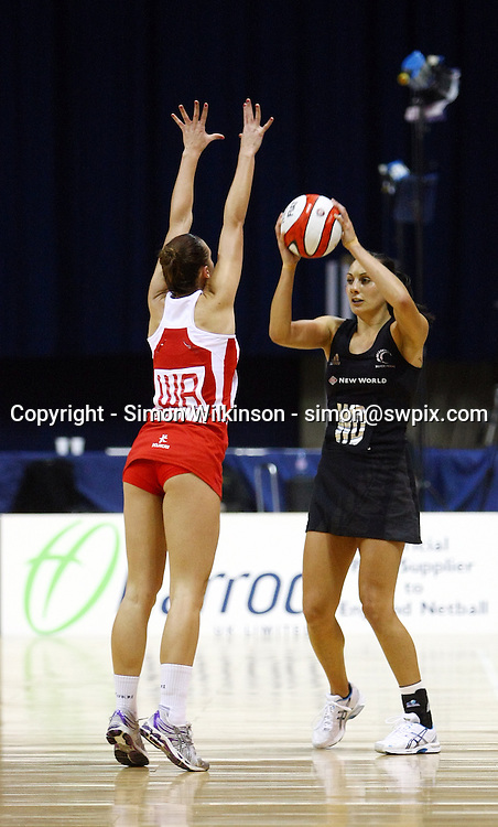 PICTURE BY VAUGHN RIDLEY/SWPIX.COM...Netball - International Netball Series - England v New Zealand - Capital FM Arena, Nottingham, England - 17/01/11...New Zealand's Joline Henry and England's Tamsin Greenway.