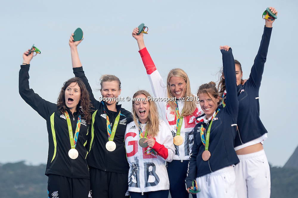 From Left: New Zealand's Jo Aleh and Polly  Powrie Silver, Great Britain's Hannah Mills<br /> Saskia Clark Gold and France's Camille Lecointre and Helene Defrance Bronze  during the medal ceremony for 470 class sailing race the 2016 Rio Olympics on Thursday the 18th of August 2016. &copy; Copyright Photo by Marty Melville / www.Photosport.nz
