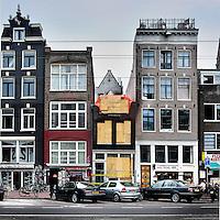 Nederland, Amsterdam , 28 juni 2012..de Nieuwezijds Voorburgwal woedde op 10 juni j.l.een uitslaande brand in een historisch pand. Daarbij is een slachtoffer om het leven gekomen..Foto:Jean-Pierre Jans