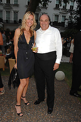 MELISSA ODABASH and ARNAUD MARTIN at a party to celebrate Le Touessrok a luxury resort in Mauritius, held at The Hempel, 31-35 Craven Hill Gardens, London W2 on 12th June 2007.<br />