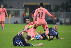November 6, 2018 - Milan, Milan, Italy - Radja Nainggolan #14 of FC Internazionale Milano competes for the ball with Ousmane Dembélé #11 of FC Barcelona and Sergio Busquets #5 of FC Barcelona during  the UEFA Champions League group B match between FC Internazionale and FC Barcelona at Stadio Giuseppe Meazza on November 06, 2018 in Milan, Italy. (Credit Image: © Giuseppe Cottini/NurPhoto via ZUMA Press)
