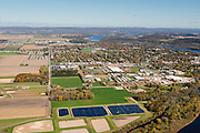 Aerial view of Prairie du Sac and Sauk City (Sauk Prairie), Wisconsin, with the Wisconsin River winding along on the right side, and the Baraboo Hills in the distance.