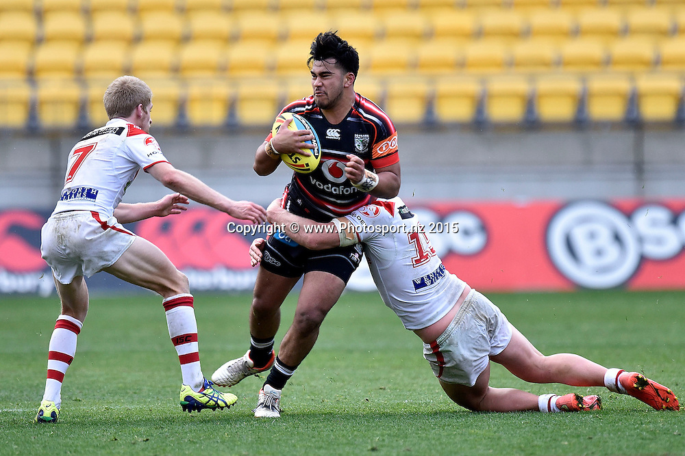 Semisi Tyrell (C of the Junior Warriors is tackled by Jay Gallagher (R and Jack Payne of the Junior Dragons during the NRL Rugby League Holden Cup match between the Junior Warriors & Junior Dragons at the Westpac Stadium in Wellington on Saturday the 8th August 2015. Copyright Photo Marty Melville / www.photosport.nz