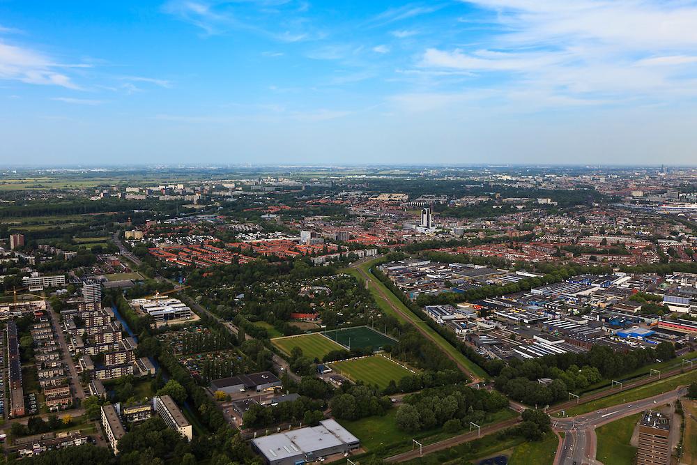 Nederland, Zuid-Holland, Vlaardingen, 23-05-2011;.Sportvelden, bedrijfsterrein en woonwijk in Vlaardingen..City of Vlaardingen near Rotterdam..luchtfoto (toeslag), aerial photo (additional fee required).copyright foto/photo Siebe Swart