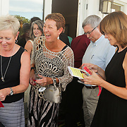 Guests mingle during Juice, Jazz & Java Saturday September 6, 2014 at Cape Fear National Golf Course in Leland, N.C. (Jason A. Frizzelle)