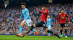 MANCHESTER, ENGLAND - Saturday, April 7, 2018: Manchester City's Leroy Sane and Manchester United's Chris Smalling during the FA Premier League match between Manchester City FC and Manchester United FC at the City of Manchester Stadium. (Pic by David Rawcliffe/Propaganda)
