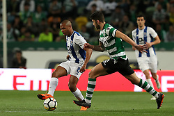 April 18, 2018 - Lisbon, Portugal - Porto's Algerian forward Yacine Brahimi (L) vies with Sporting's defender Cristiano Piccini from Italy during the Portugal Cup semifinal second leg football match Sporting CP vs FC Porto at the Alvalade stadium in Lisbon on April 18, 2018. (Credit Image: © Pedro Fiuza/NurPhoto via ZUMA Press)