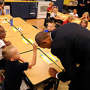 President Barack Obama allows 1st grader Edwin Donley to touch his hair after the student remarked how short the President's hair was at Clarence Tinker Elementary School on MacDill Air Force Base Wednesday, Sept. 17, 2014 in Tampa. The President made a stop at the school after speaking to service men and women at MacDill AFB. The President arrived in Tampa on Tuesday evening and met with Centcom commander Gen. Lloyd Austin III and other leaders at MacDill, including members of the Centcom international coalition.