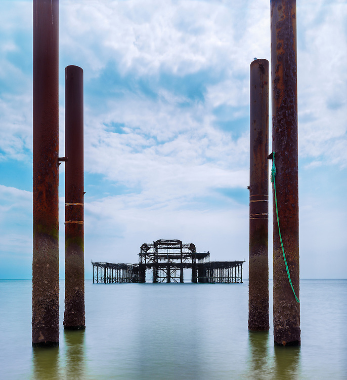Remains of an old Victorian Pier sit forlornly just off Brighton's seafront