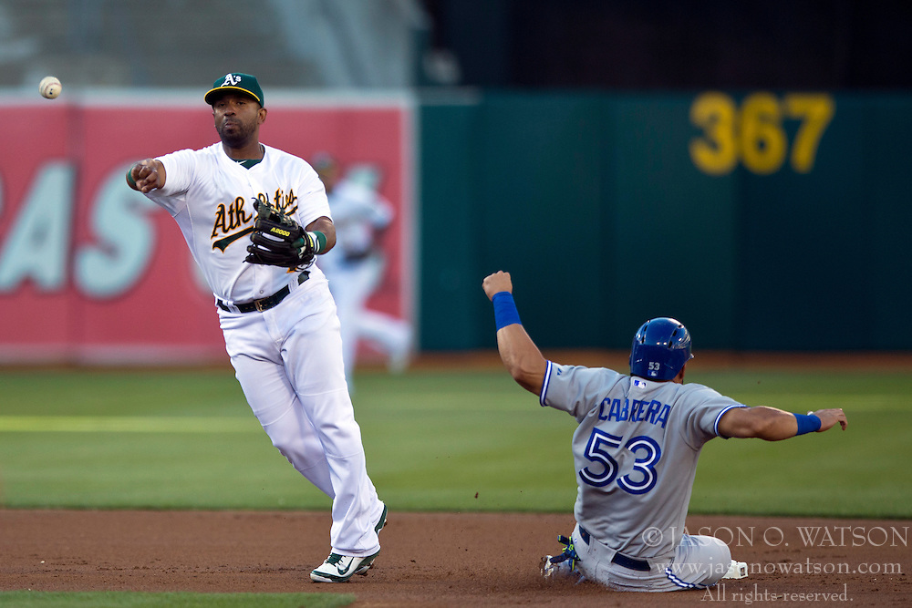 OAKLAND, CA - JULY 05:  Alberto Callaspo #7 of the Oakland Athletics is unable to complete a double play after forcing out Melky Cabrera #53 of the Toronto Blue Jays at second base during the first inning at O.co Coliseum on July 5, 2014 in Oakland, California. The Oakland Athletics defeated the Toronto Blue Jays 5-1.  (Photo by Jason O. Watson/Getty Images) *** Local Caption *** Alberto Callaspo; Melky Cabrera