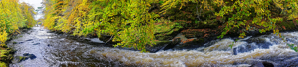 A bend in the River Dochart, near Killin, in the Stirling area of Scotland, with autumnal colours,.