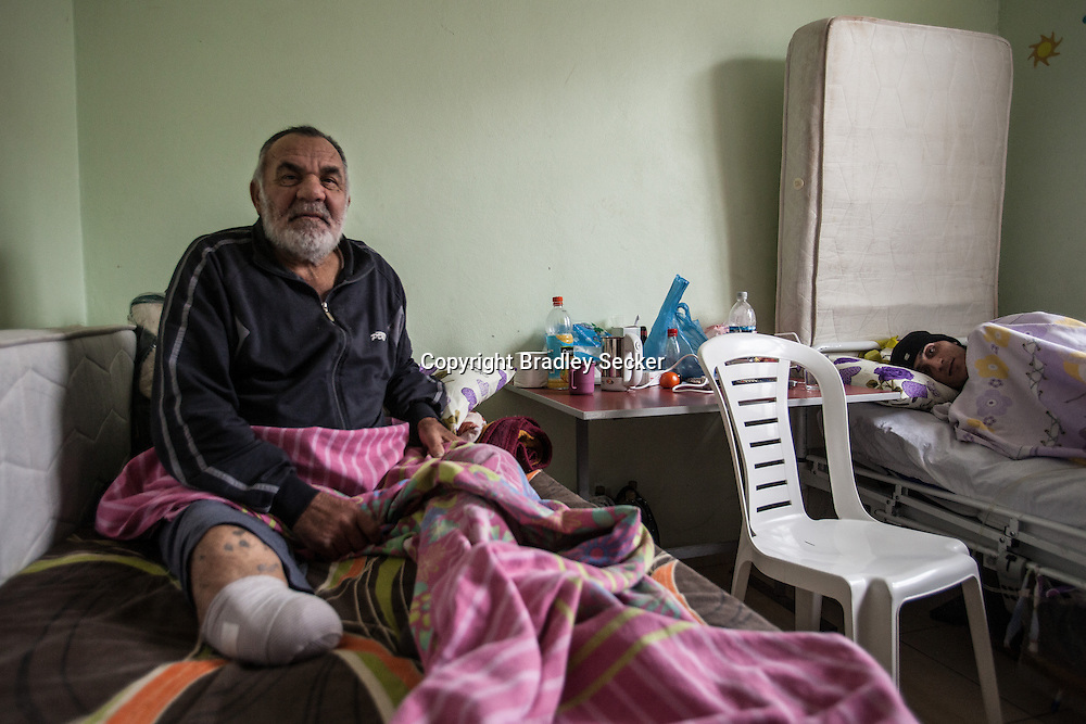 Abu Zamar, 60, is now with his wife in a post-care centre in the Turkish border town of Reyhanli, after his house was bombed in Syria. His right leg has been amputated. 04/01/2013