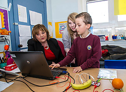 Pictured: Ms Hyslop and Carla Hay, Yourh Project Intative projects assistant joined with Ryan Collins to change tones of sounds<br /> <br /> Culture Secretary Fiona Hyslop MSP unveiled cash awards for Youth Music Initiative schemes which will help young people learn about and enjoy music. Ms Hyslop made the announcement when she joined schoolchildren at Longstone Primary School, Edinburgh today.<br /> <br /> <br /> Ger Harley | EEm 8 March 2018