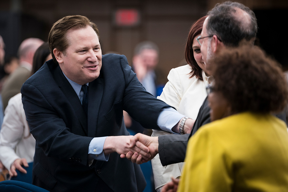 Michael Verveer, Alder District 4, shakes hands with an incoming Alder after being sworn in at the City County Building in Madison, WI on Tuesday, April 16, 2019.