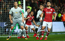 20 December 2017 -  EFL Cup (1/4 Final) - Bristol City v Manchester United - Bobby Reid of Bristol City jostles with Victor Lindelof of Manchester United - Photo: Marc Atkins/Offside