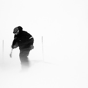 A Jackson Hole Mountain Resort Employee braves the wind to remove snow from around Corbet's Cabin.