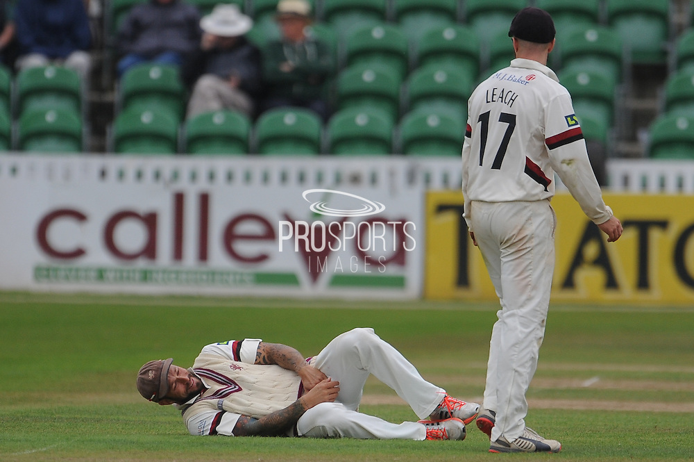 Peter Trego takes a blow as Jack Leach looks on during the LV County Championship Div 1 match between Somerset County Cricket Club and Hampshire County Cricket Club at the County Ground, Taunton, United Kingdom on 11 September 2015. Photo by David Vokes.