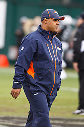 December 19, 2010; Oakland, CA, USA;  Denver Broncos interim head coach Eric Studesville watches his team warm up before the game against the Oakland Raiders at Oakland-Alameda County Coliseum. Oakland defeated Denver 39-23.