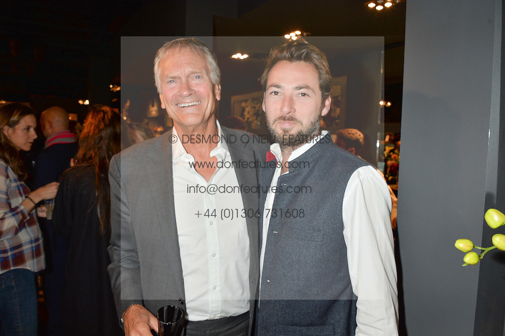 Left to right, CHARLES DELEVINGNE and CHARLIE CROSSLEY at a party to celebrate the publication of Flourish by Willow Crossley held at OKA, 155-167 Fulham Rd, London on 4th October 2016.