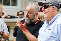 """© Licensed to London News Pictures. 07/09/2019. London, UK. A Pro Brexit protester is seen bleeding as he was by the confronted police officers in Whitehall as anti-Brexit protesters take part in """"Defend our Democracy and Stop Brexit"""" demonstration in Whitehall, Westminster. The protesters are demonstrating against the British Prime Minister Boris Johnson's intention to prorogue Parliament until 14 October. Photo credit: Dinendra Haria/LNP"""