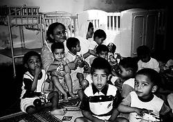 Pakistan, Karachi, 2004. Bilquis Edhi helps manage some of the many abandoned children the Edhi Foundation raises.