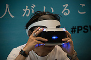 """A visitor experiences a Sony PlayStation VR headset during a preview at the exhibition """"Odaiba Dream Experience presented by PlayStation VR'' at the Fuji Television Headquarters Building, in Tokyo. 26/07/2016-Tokyo, JAPAN"""